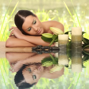 woman relaxing in spa, with reflection on the water